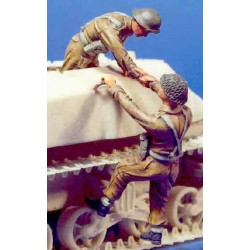 UK soldiers climbing onto vehicle