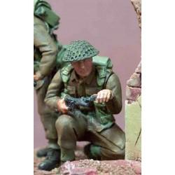 Soldier kneeling with Sten